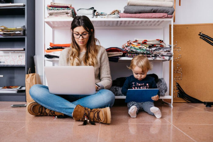 Mom and child with computers on floor